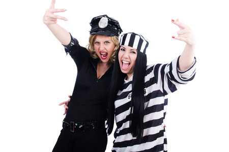 Prisoner and police isolated on the white Stock Photo - 23877332