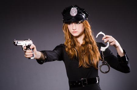 Woman police office with gun photo