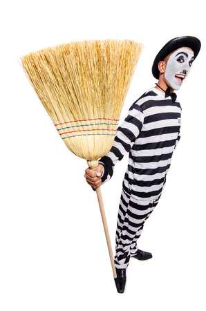 Prisoner with broom isolated on the white Stock Photo - 23877462
