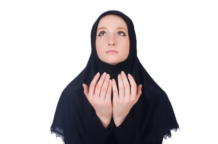 Young muslim woman praying isolated on white Stock Photo - 23853822