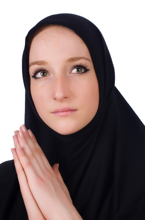Young muslim woman praying isolated on white Stock Photo - 23853851