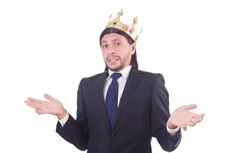 Businessman with crown isolated on white photo