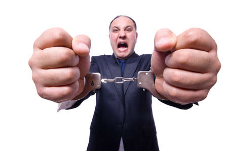prison ball: Businessman with handcuffs on white