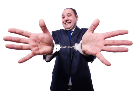 Businessman with handcuffs on white photo