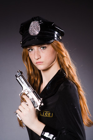 Redhead police office with gun photo