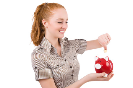 Redhead with piggybank isolated on the white photo