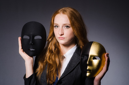 Woman with mask in hypocrisy concept Stock Photo - 23924129
