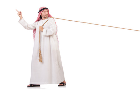 Arab in tug of war concept on white photo