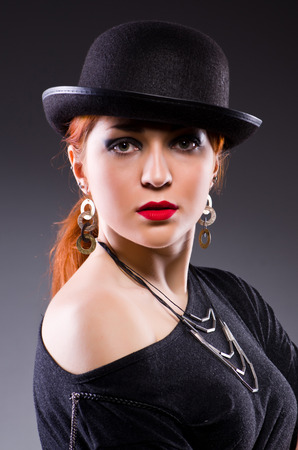 Woman in retro concept in dark room Stock Photo - 23924249