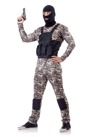 Soldier in camouflage with gun on white photo