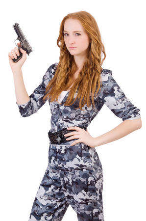 bulletproof vest: Young woman soldier with gun on white