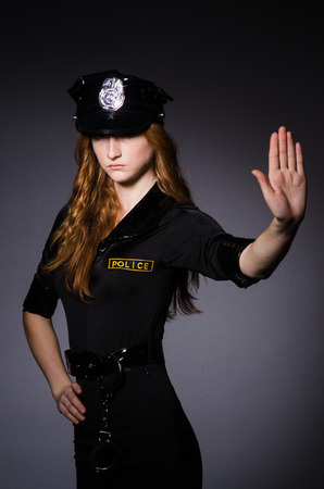 Woman police office in dark room Stock Photo - 23922078