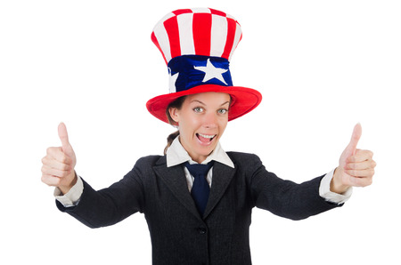 Young woman with american symbols on white photo