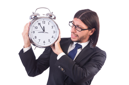 Young businessman with clock on white photo