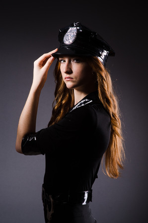 Woman police office in dark room photo