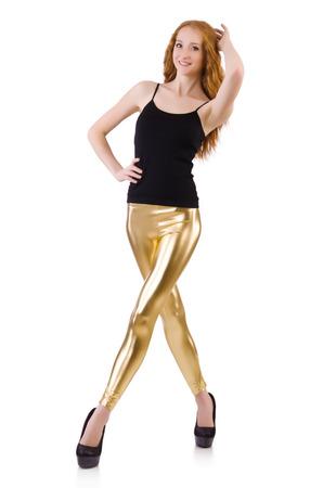 Young redhead girl in tight leggings photo