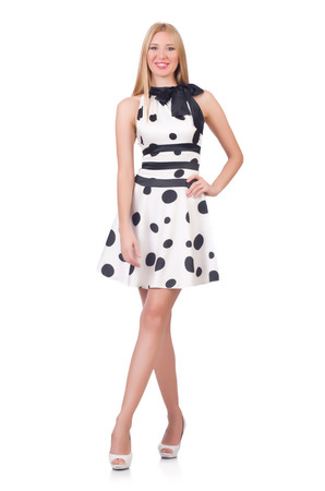 tall: Tall model dressed in dress with polka dosts on white