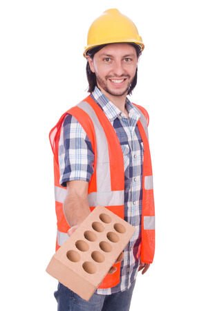 Builder with clay bricks isolated on white photo