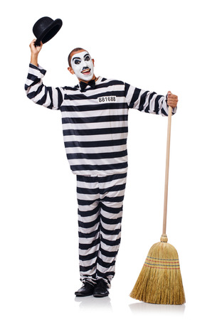 Prisoner with broom isolated on the white Stock Photo - 24576925