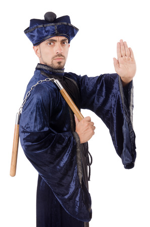 Martial arts master with nunchucks on white photo
