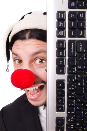 Funny clown with keyboard isolated on white photo