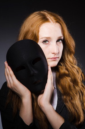 hypocrisy: Woman with mask in hypocrisy concept