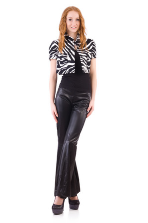 bell bottoms: Redhead woman in black bell bottom pants on white Stock Photo