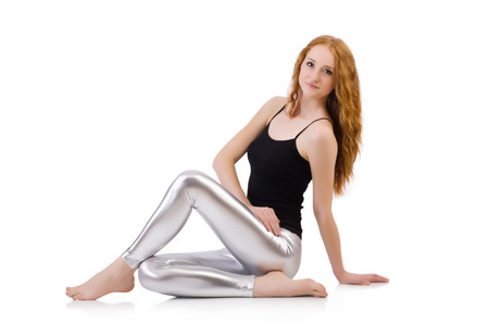 Young redhead girl in tight leggings photo