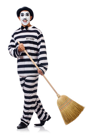 Prisoner with broom isolated on the white Stock Photo - 27196325