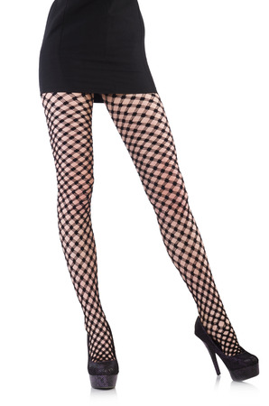 Woman in fishnet stockings isolated on white photo