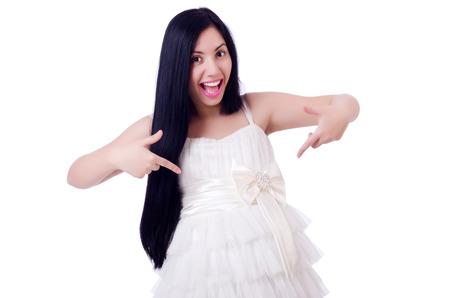 Pregnant woman in wedding dress on white photo