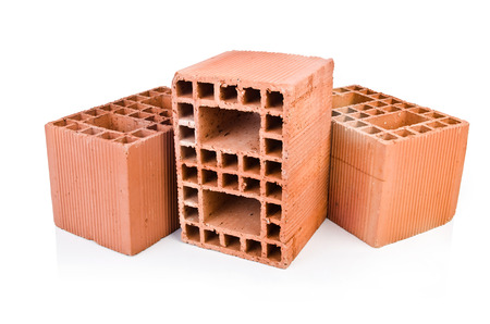 Stack of clay bricks isolated on white photo