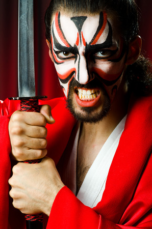 Man with sword and face mask Stock Photo - 26661110