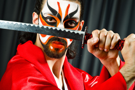 Man with sword and face mask Stock Photo - 26661119