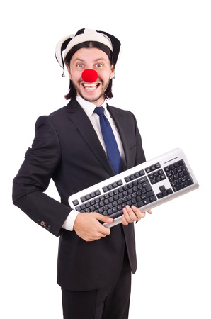 Funny clown with keyboard isolated on white Stock Photo - 26660951
