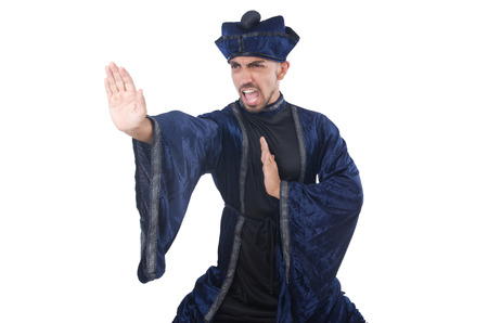 Old martial arts master in blue kimono on white photo