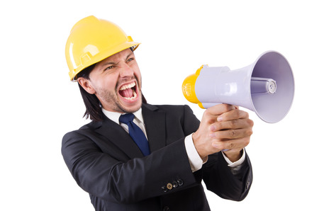 Man with helmet and loudspeaker on white photo