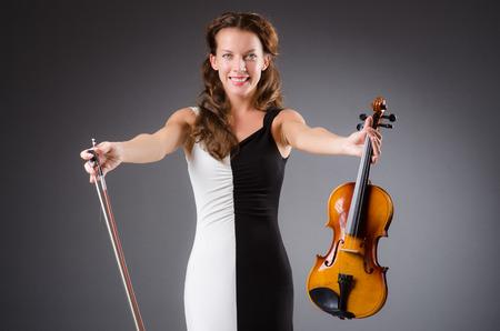 virtuoso: Woman artist with violin in music concept Stock Photo