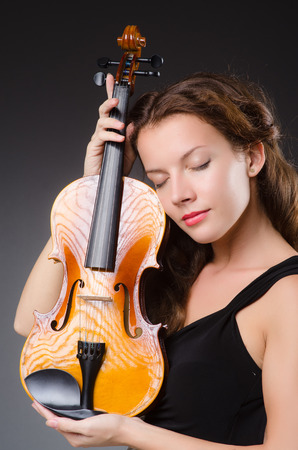 solo violinist: Woman artist with violin in music concept Stock Photo