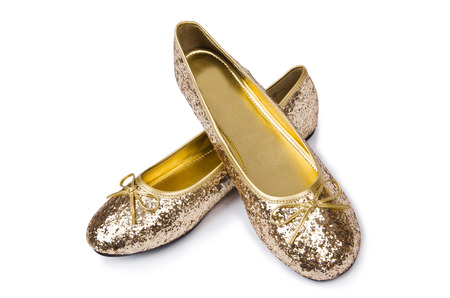 Golden ballet shoes isolated on white photo