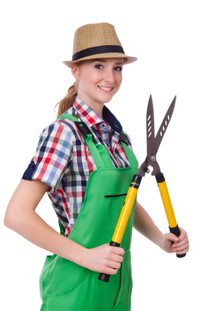 Young woman with shears on white photo