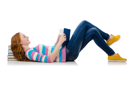 Young student with books isolated on white photo