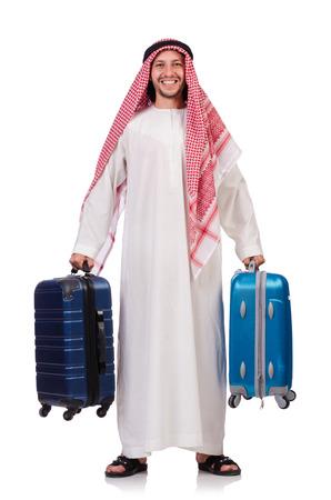 Arab man with luggage on white photo