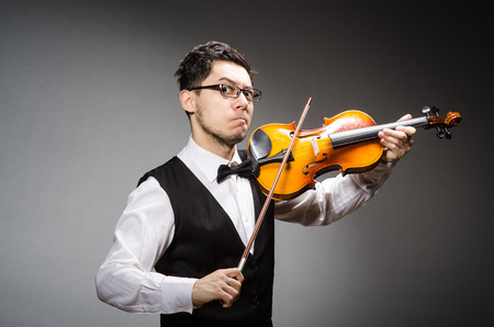 Funny violin player with fiddle photo