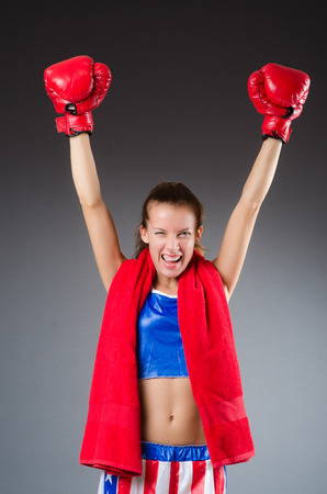 Woman boxer in uniform with US symbols photo