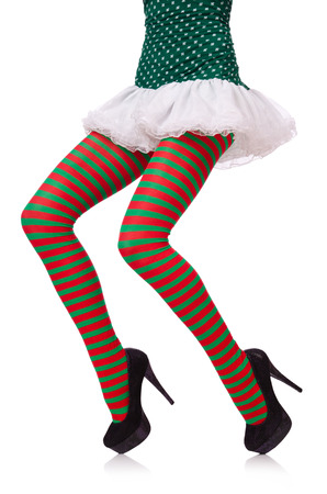 Woman legs in striped stockings on white photo