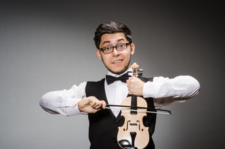 Funny violin player with fiddle Stock Photo - 27219449