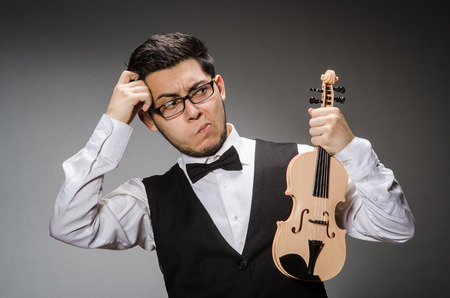 Funny violin player with fiddle Stock Photo - 27219453