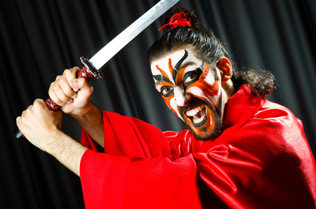 Man with sword and face mask Stock Photo - 27219461