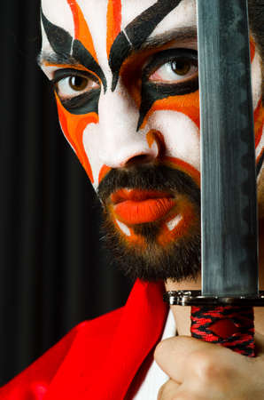 Man with sword and face mask Stock Photo - 27219466